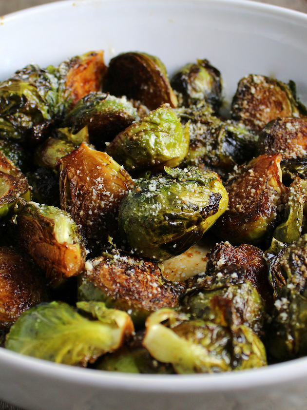 Eye Level Close Up Partial Serving Dish of Brussel Sprouts with Parmesan Cheese