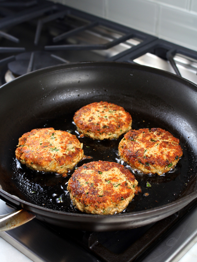 fish cakes frying in saute pan
