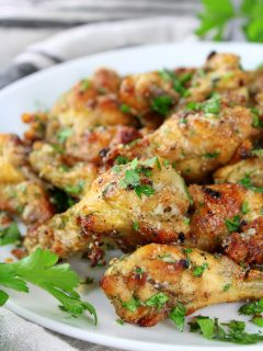 close up partial plate of garlic parmesan wings