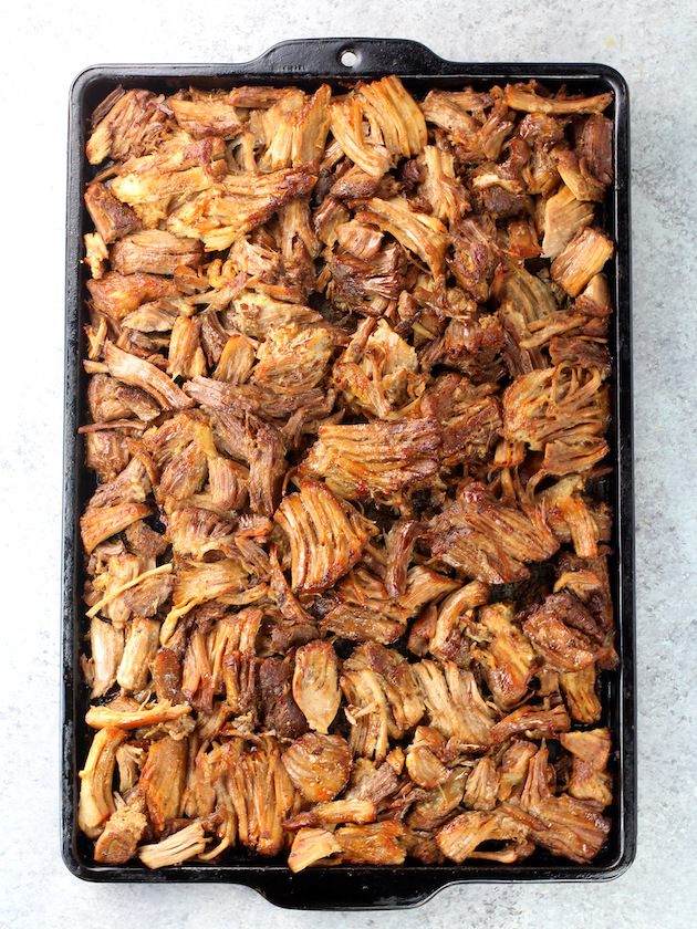 Baking sheet full of shredded pork carnitas