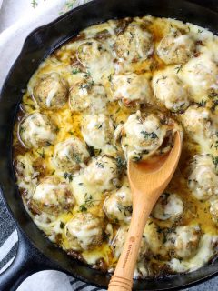 skillet with cheesy french onion chicken meatballs