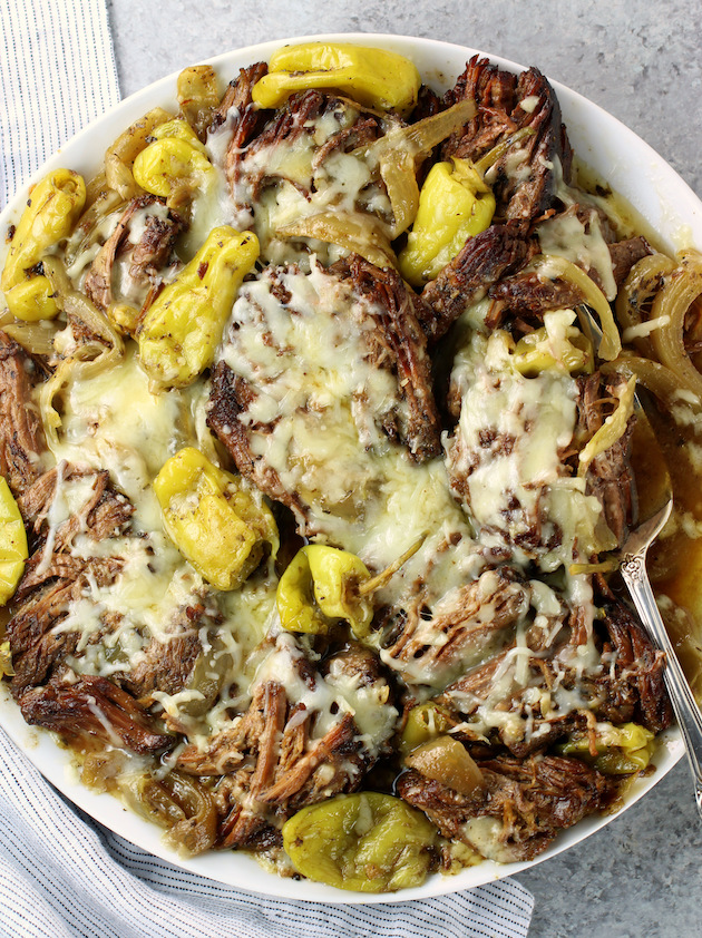 Partial platter of slow cooker low carb italian beef with pepperoncini and melted cheese