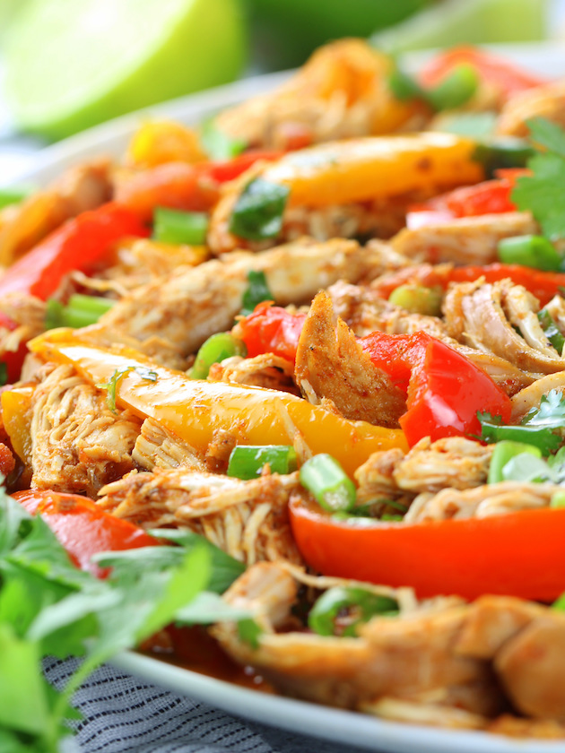 close up eye level partial platter of low carb chicken fajitas