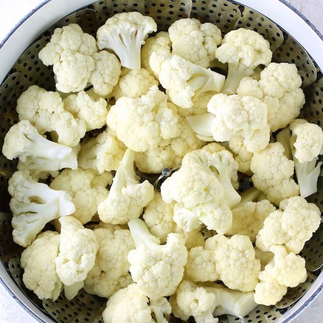 cauliflower florets in a steamer basket