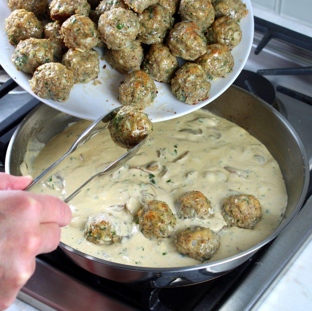 Adding turkey meatballs to saute pan on stovetop