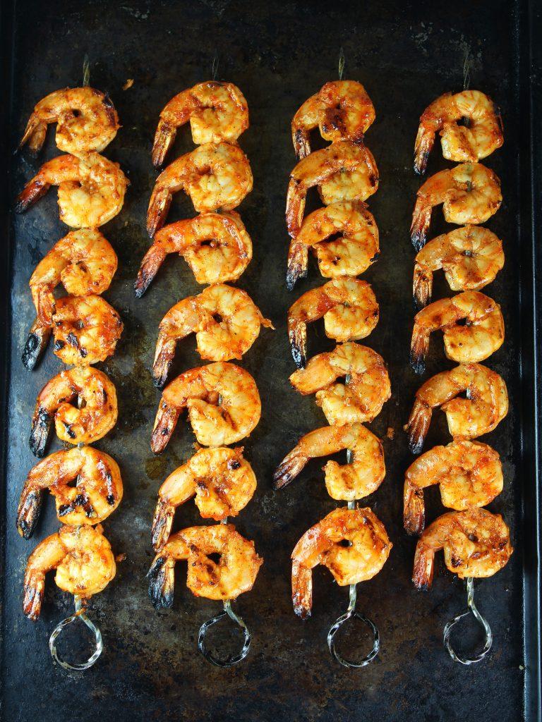 grilled gulf shrimp skewers on baking sheet after grilling