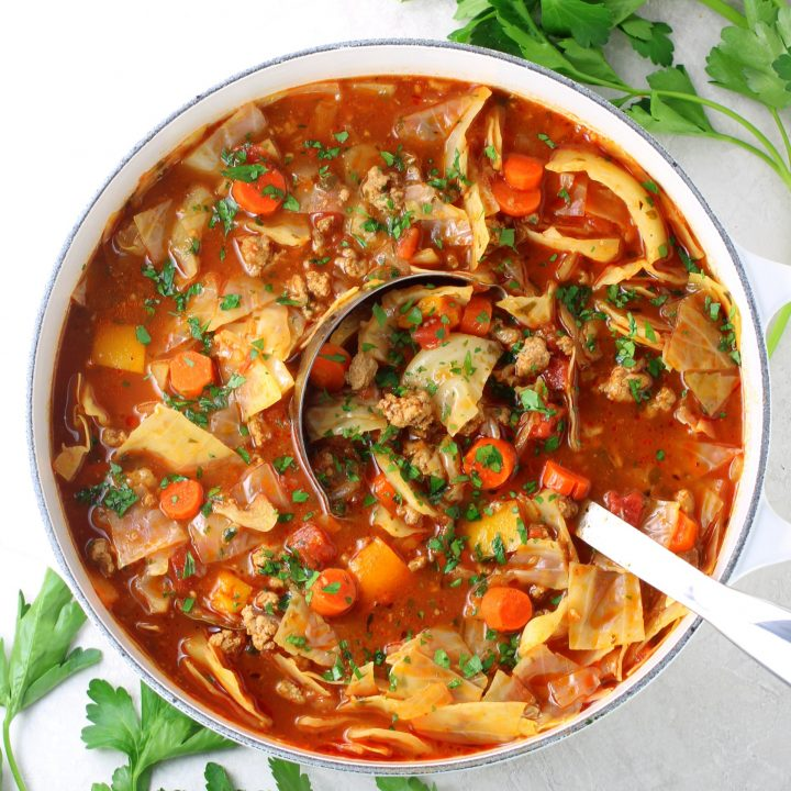 cabbage roll soup in a white soup pot with ladle