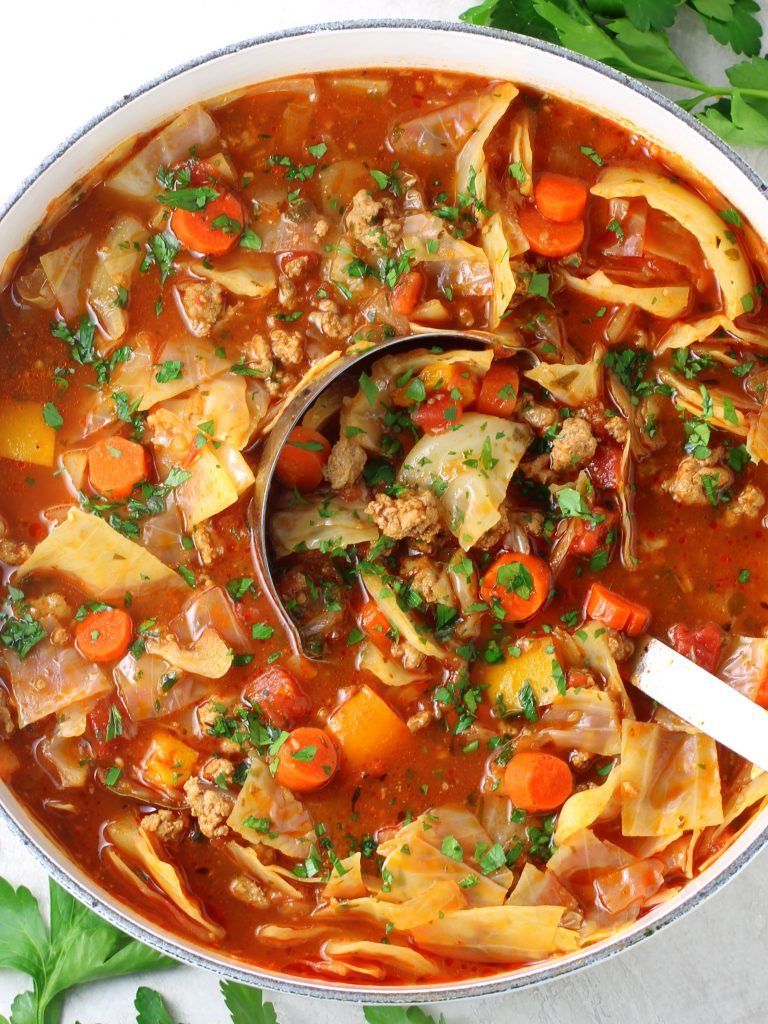 ladle in a pot of low carb cabbage roll soup