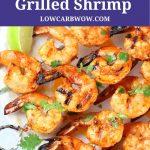 partial platter of skewered grilled shrimp