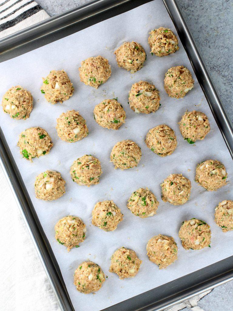 turkey meatballs on baking sheet before cooking
