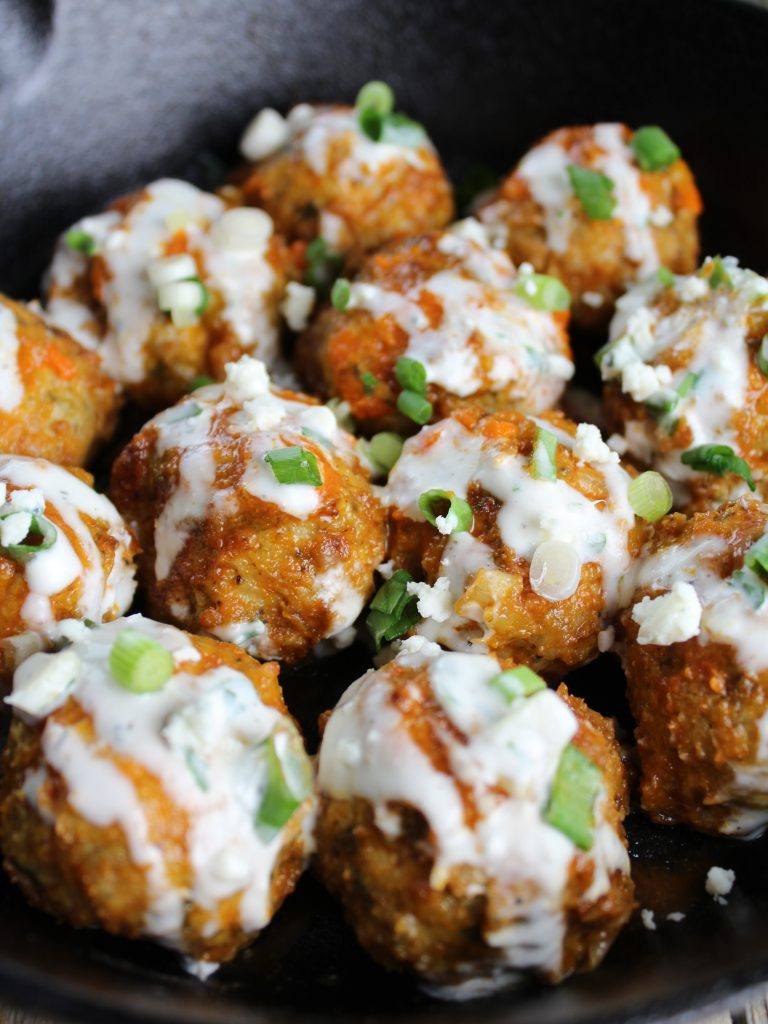 buffalo chicken meatballs with blue cheese sauce in skillet